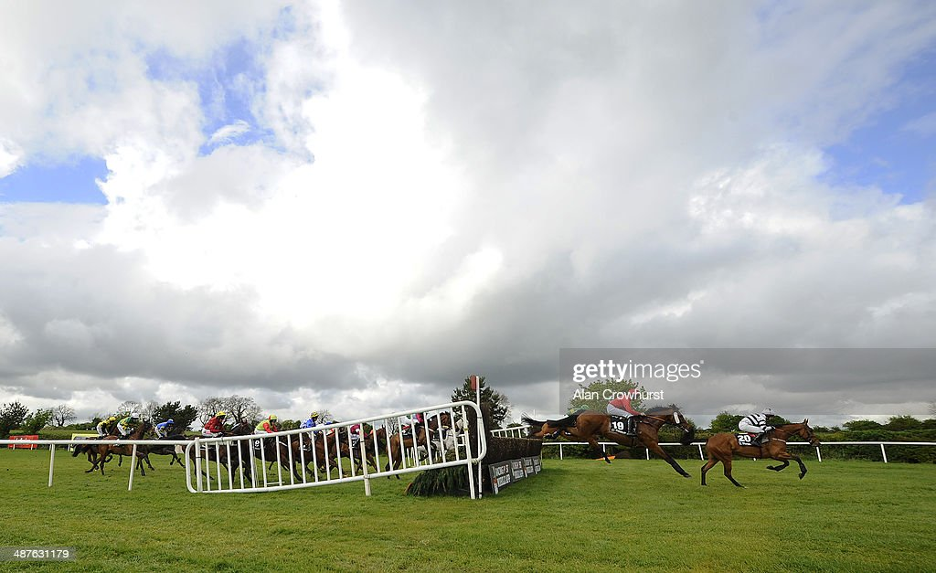 A general view as runners clear a fence before making their way down the side of the track at Punchestown racecourse on May 01, 2014 in Naas, Ireland.