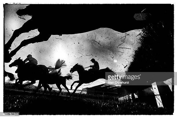 A general view as runners clear a fence in The Ultima Business Solutions Handicap Steeple Chase at Cheltenham racecourse on March 10 2015 in...
