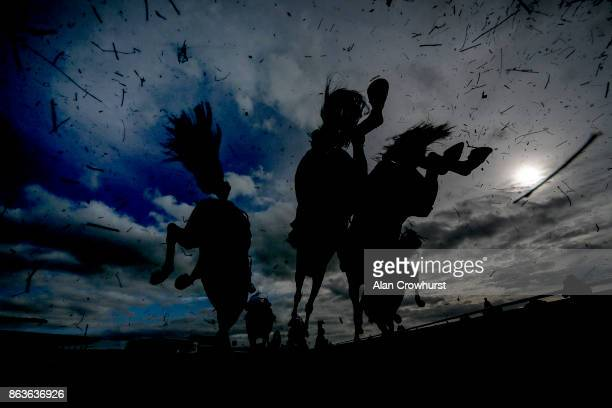 A general view as runners clear a fence in The Wessex Waste Disposal Handicap Steeple Chase at Wincanton racecourse on October 20 2017 in Wincanton...