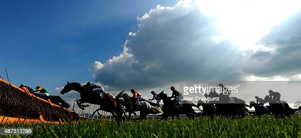 A general view as runners clear a flight of hurdles at Punchestown racecourse on April 29 2014 in Naas Ireland