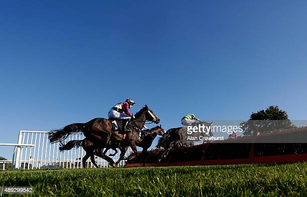 A general view as runners clear a flight of hurdles in The midsussexflooringcouk Handicap Hurdle Race at Plumpton racecourse on September 20 2015 in...