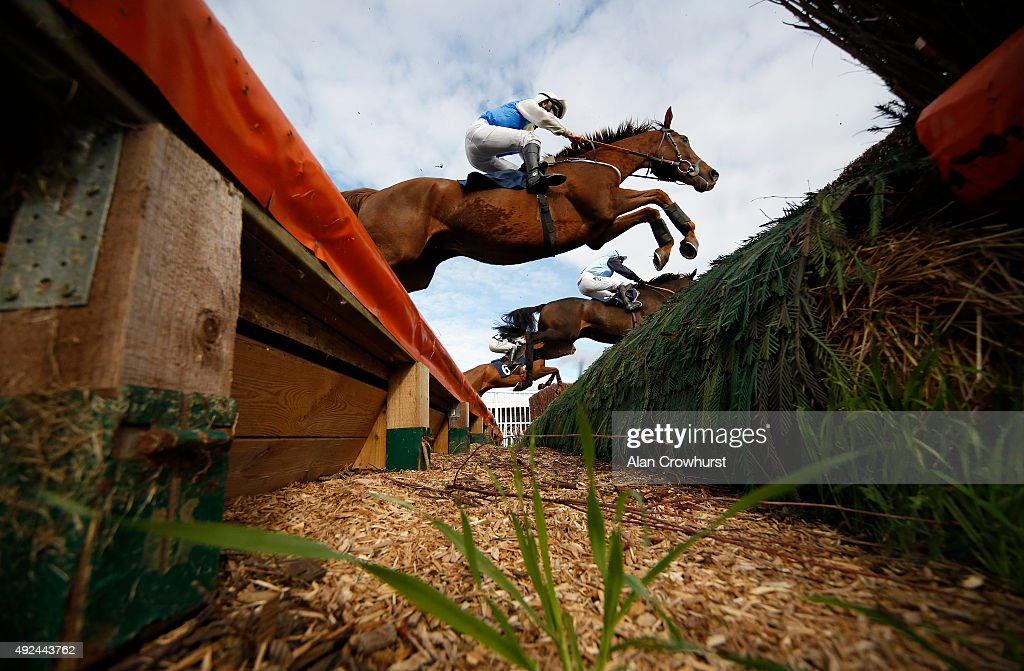 A general view as runners clear an open ditch at Huntingdon racecourse on October 13 2015 in Huntingdon England