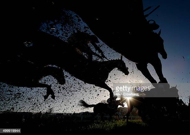 A general view as runners clear the open ditch in front of the grandstands at Sandown racecourse on December 04 2015 in Esher England