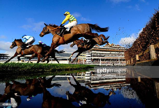 A general view as runners clear the water jump at Newbury racecourse on November 27 2014 in Newbury England