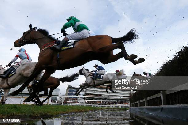 A general view as runners clear the water jump at Newbury Racecourse on March 4 2017 in Newbury England