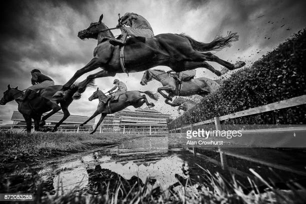 A general view as runners clear the water jump in The Dawnus Handicap Steeple Chase at Newbury racecourse on November 9 2017 in Newbury United Kingdom