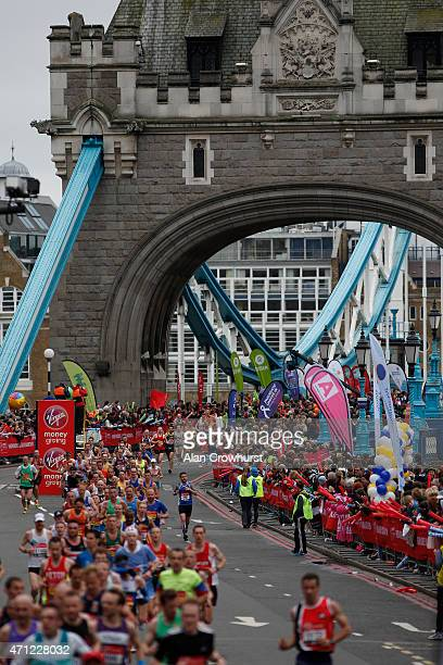 A general view as runners cross over Tower Bridge during the Virgin Money London Marathon on April 26 2015 in London England