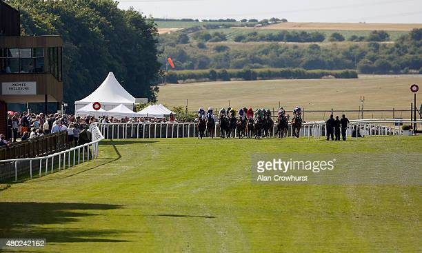 A general view as runners cross the finishing line at Newmarket racecourse on July 10 2015 in Newmarket England