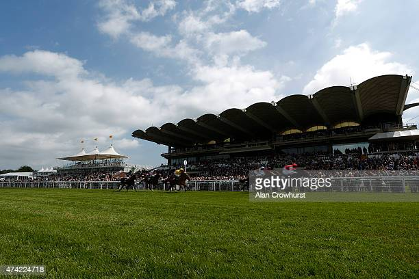 A general view as runners flash by the grandstands at Goodwood racecourse on May 21 2015 in Chichester England