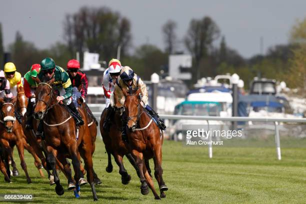 A general view as runners in the MPM Flooring Ltd Handicap Stakes make their way past the Racecourse Marina at Windsor Racecourse on April 10 2017 in...