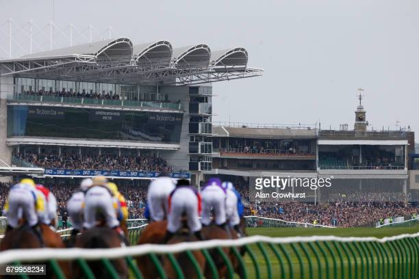 A general view as runners in The Qatar Racing Handicap Stakes make their way towards the grandstands and finish at Newmarket Racecourse on May 7 2017...