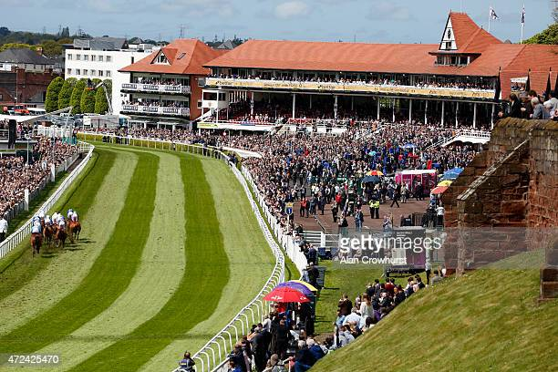 A general view as runners lrace up the straight in front of the grandstands at Chester racecourse on May 07 2015 in Chester England