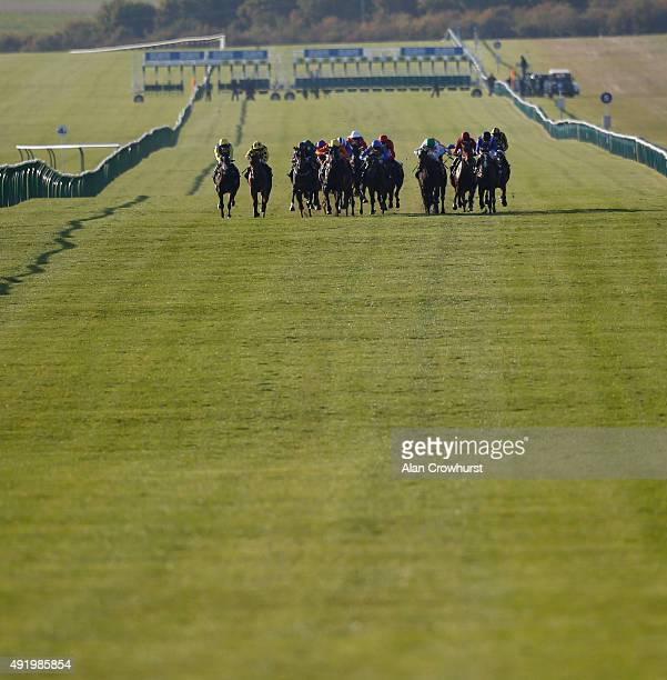A general view as runners make their way down the Rowley mile course at Newmarket racecourse on October 09 2015 in Newmarket England