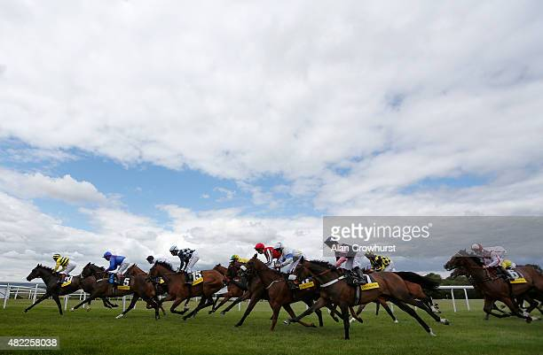A general view as runners make their way into the straight at Goodwood racecourse on July 29 2015 in Chichester England