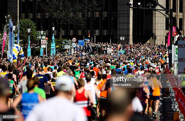 A general view as runners make their way over Tower Bridge during the Virgin Money London Marathon on April 13 2014 in London England
