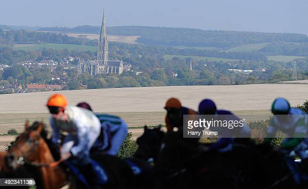 General view as runners make their way past Salisbury Cathedral during the Bathwick Car and Van Hire Maiden Auction Stakes at Salisbury Racecourse on...