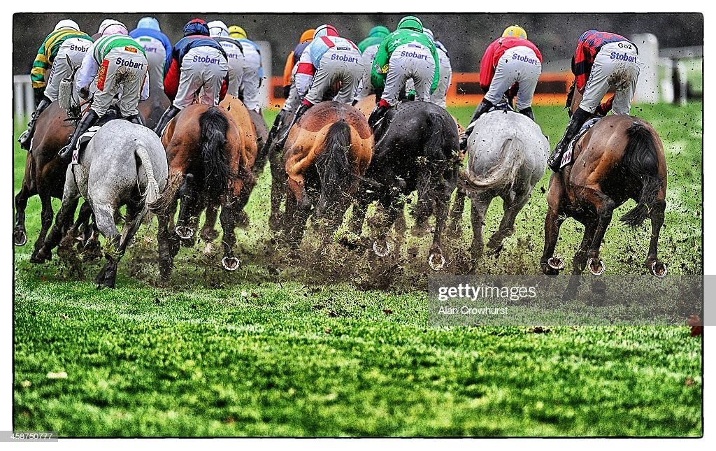 A general view as runners make their way through the heavy going at Ascot racecourse on December 21, 2013 in Ascot, England.
