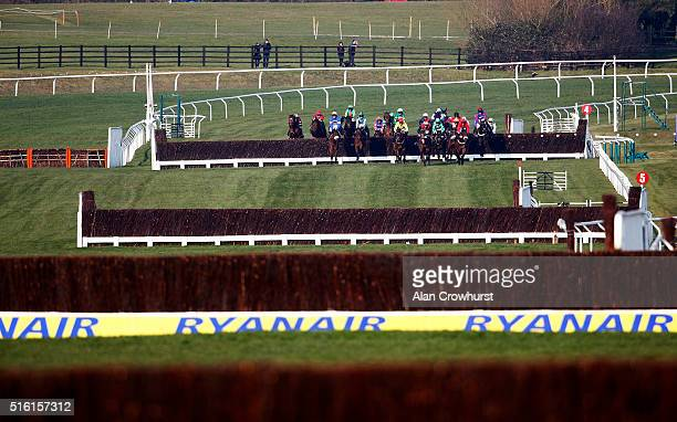 A general view as runners make their way up the straight during Cheltenham Festival St Patrick's Thursday at Cheltenham racecourse on March 17 2016...