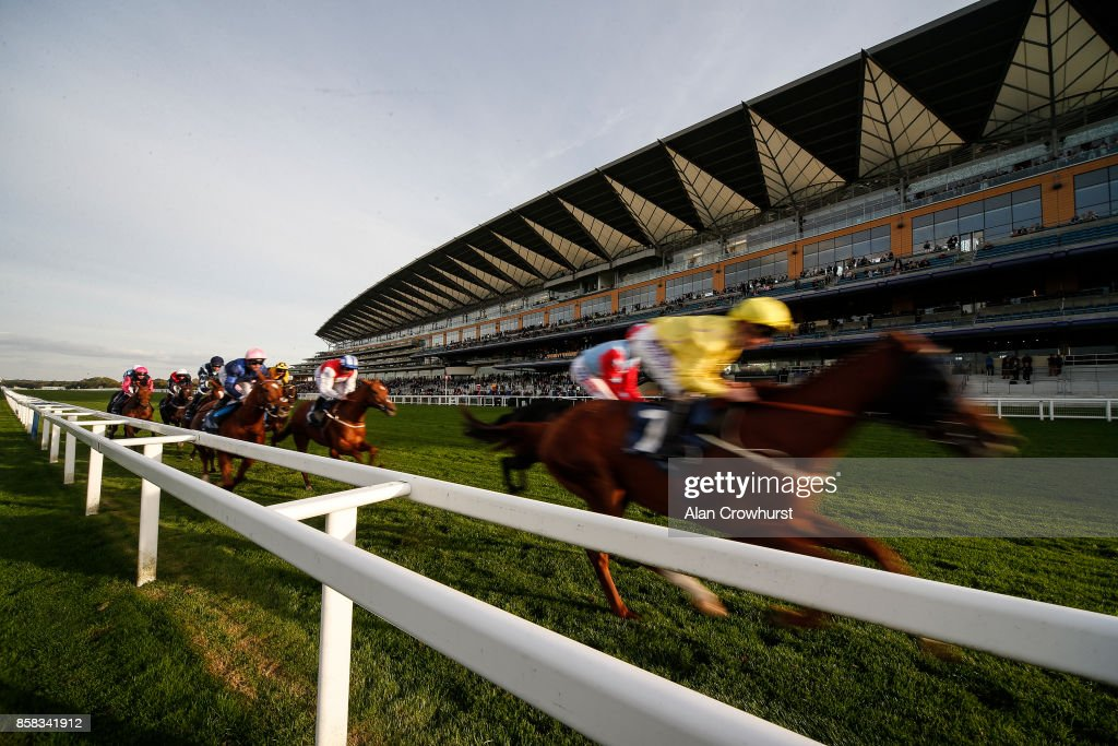 A general view as runners pass the grandstand with a circuit to go at Ascot racecourse on October 6, 2017 in Ascot, United Kingdom.