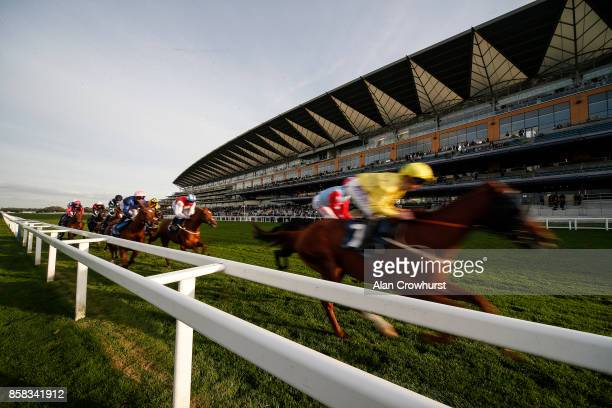 A general view as runners pass the grandstand with a circuit to go at Ascot racecourse on October 6 2017 in Ascot United Kingdom