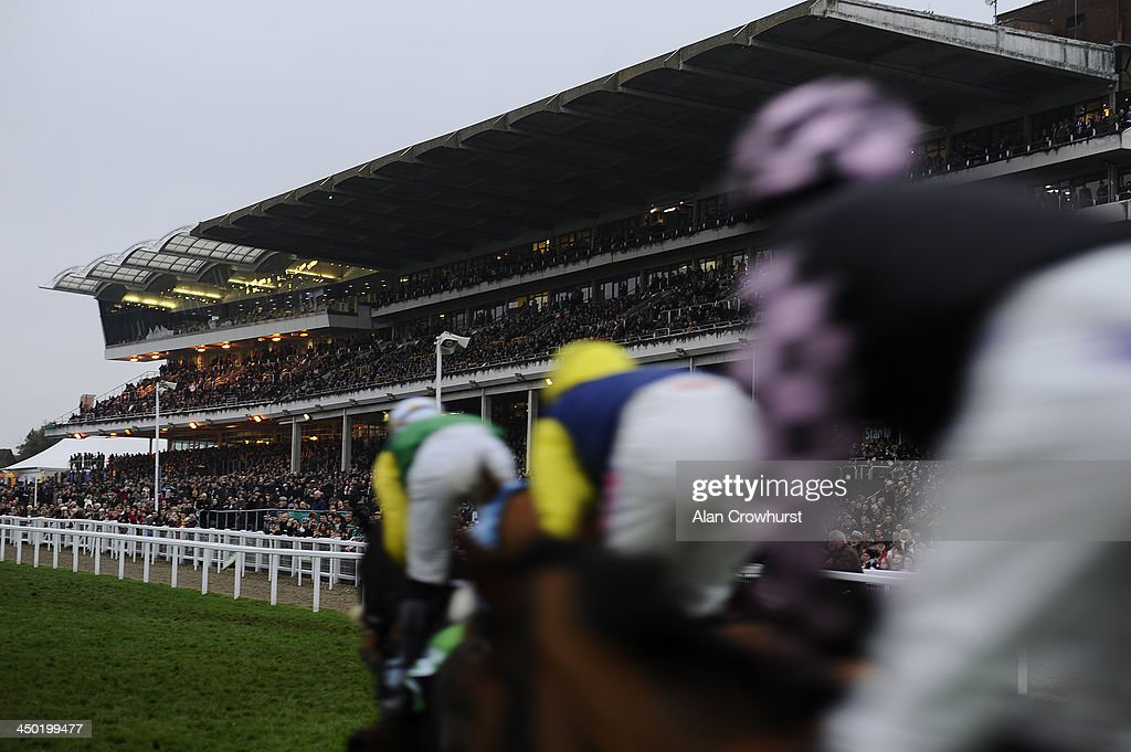 A general view as runners pass the grandstands at Cheltenham racecourse on November 17, 2013 in Cheltenham, England.