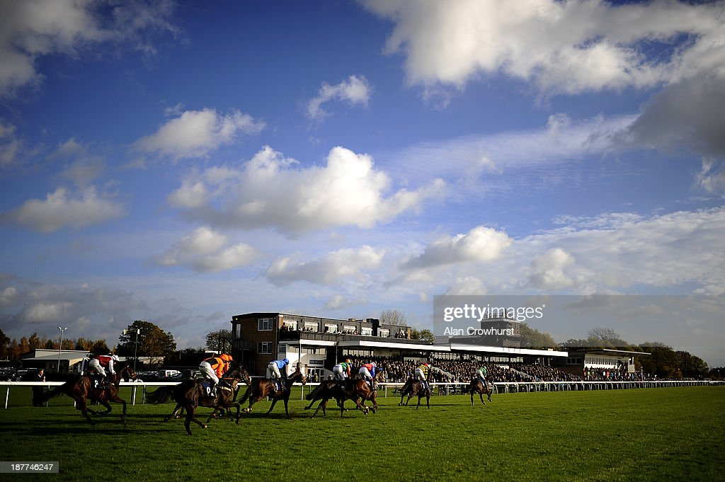 A general view as runners pass the grandstands at Huntingdon racecourse on November 12 2013 in Huntingdon England