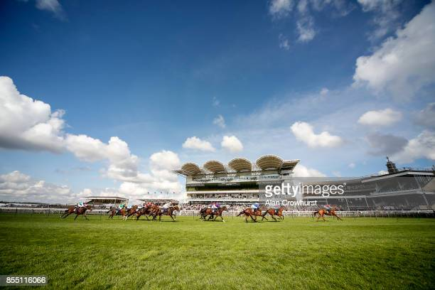A general view as runners pass the grandstands at the end of the race at Newmarket racecourse on September 28 2017 in Newmarket United Kingdom
