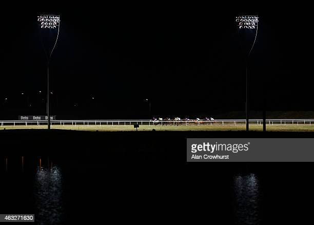 A general view as runners race around the top bend under floodlights at Chelmsford City racecourse on February 12 2015 in Chelmsford England