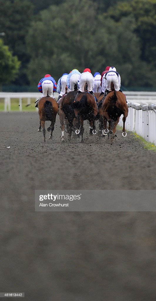 A general view as runners race down the back straight at Kempton Park racecourse on July 02, 2014 in Sunbury, England.