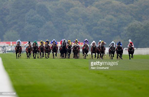 A general view as runners race down the straight in The Ladbrokes Portland at Doncaster racecourse on September 13 2014 in Doncaster England