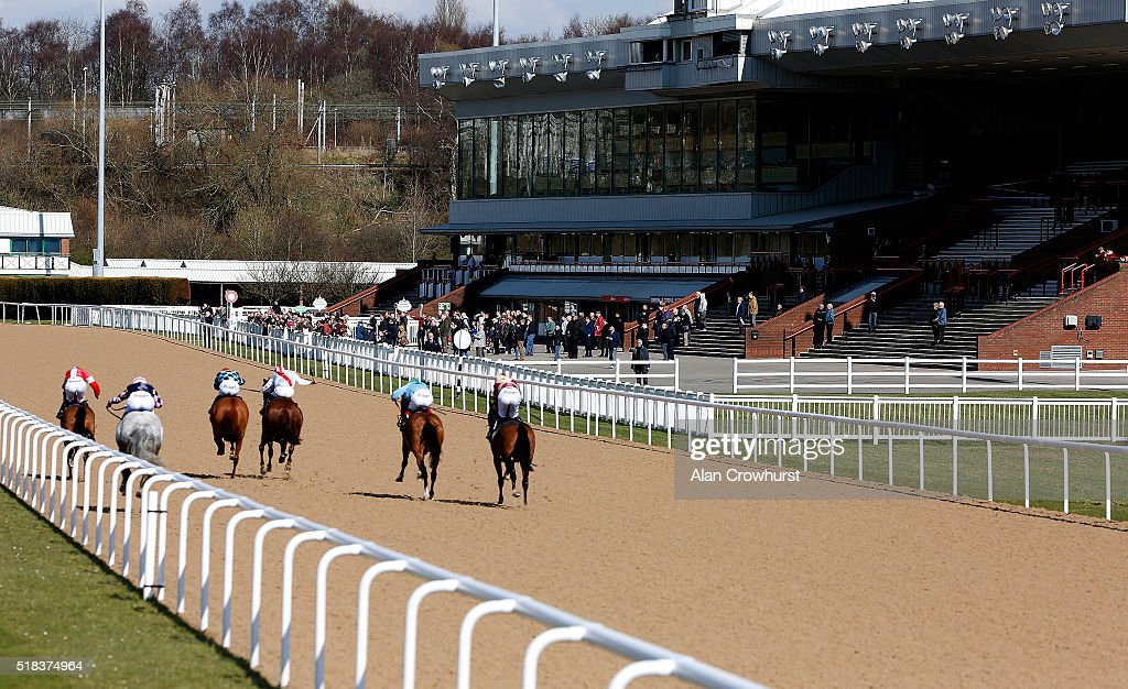 A general view as runners race towards the finish and grandstands at Wolverhampton racecourse on March 31 2016 in Wolverhampton England