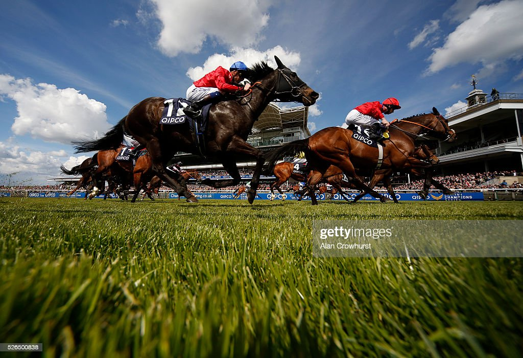 A general view as runners race towards the finish at Newmarket racecourse on April 30, 2016 in Newmarket, England.