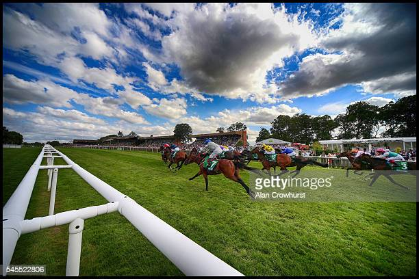 A general view as runners race towards the finish at Newmarket Racecourse on July 8 2016 in Newmarket England