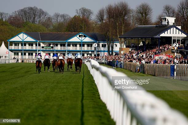 A general view as runners race towards the finish at Windsor racecourse on April 20 2015 in Windsor England