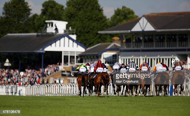 A general view as runners race towards the finish in The betdaqcom £20 Free Bet Median Auction maiden Stakes at Windsor racecourse on June 22 2015 in...