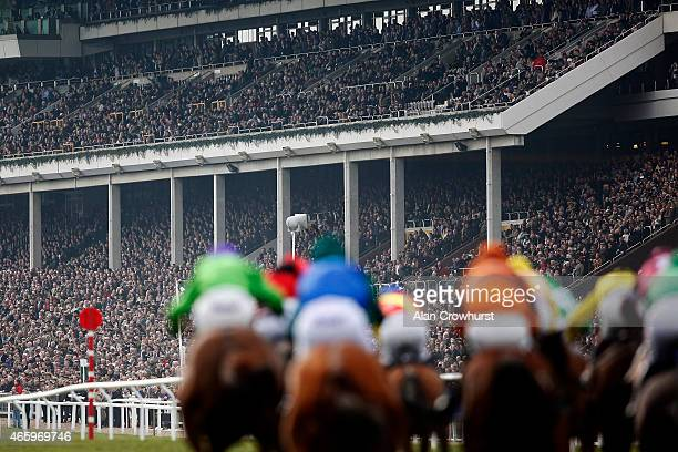 A general view as runners race up the straight at Cheltenham racecourse on March 12 2015 in Cheltenham England
