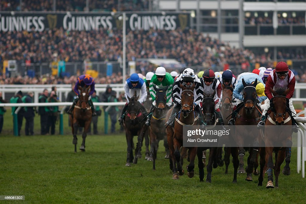 A general view as runners turn away from the grandstands during Gold Cup day at the Cheltenham Festival at Cheltenham racecourse on March 13 2015 in...
