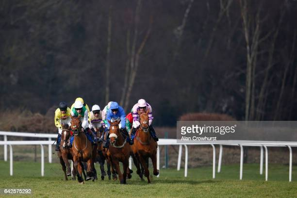 A general view as runners turn down the side of he track at Ascot Racecourse on February 18 2017 in Ascot England