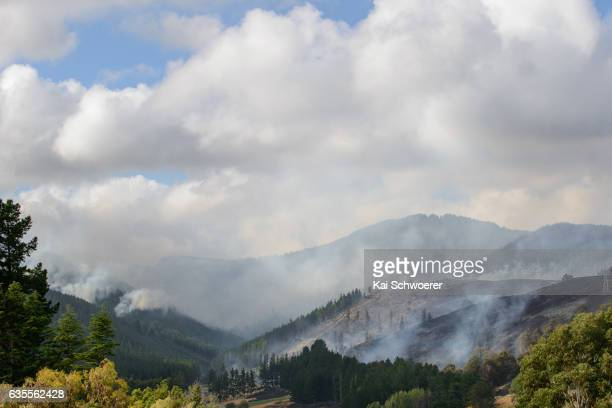 General view as smoke and fire light up around Christchurch Adventure Park on February 16 2017 in Christchurch New Zealand A state of emergency has...
