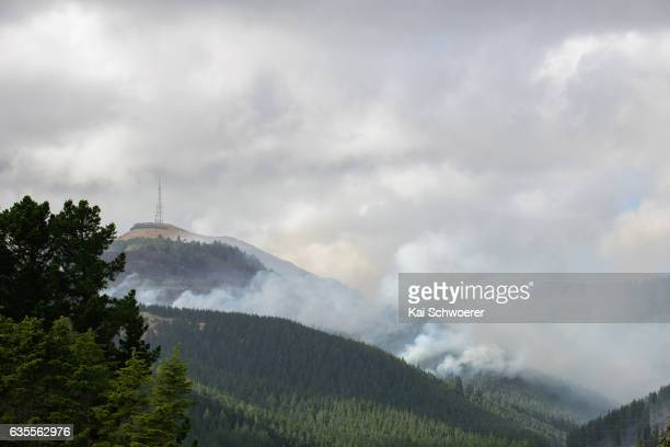 General view as smoke and fire light up between Sugarloaf communications tower and Christchurch Adventure Park on February 16 2017 in Christchurch...