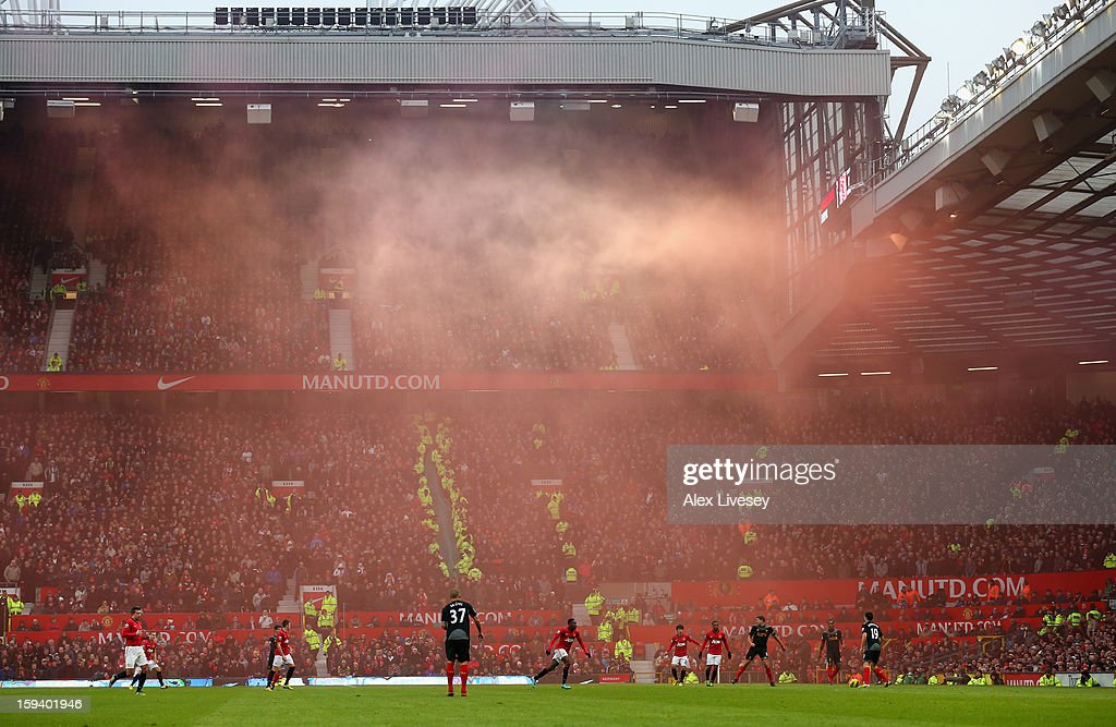 General View as smoke from a flare drifts across the pitch during the Barclays Premier League match between Manchester United and Liverpool at Old Trafford on January 13, 2013 in Manchester, England.