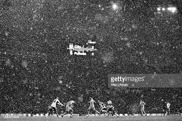 General View as snow falls during the Barclays Premier League match between Manchester City and Fulham at the Etihad Stadium on February 4 2012 in...