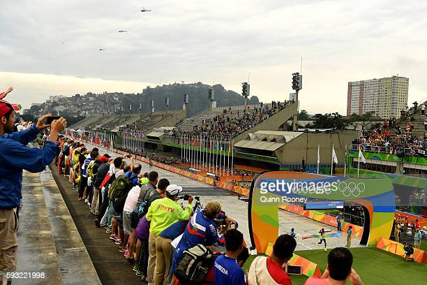 A general view as spectators watch as Eliud Kipchoge of Kenya crosses the line to win gold during the Men's Marathon on Day 16 of the Rio 2016...