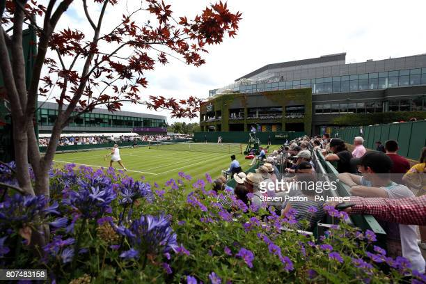 General view as spectators watch the action on court seventeen between Anastasia Pavlyuchenkova and Arina Rodionova on day two of the Wimbledon...