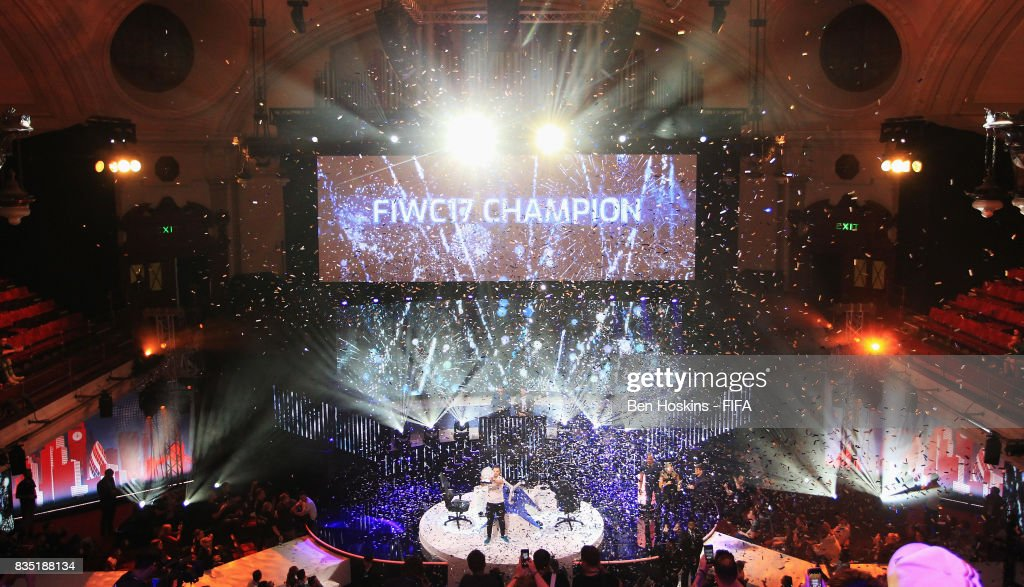 A general view as Spencer 'Gorilla' Ealing of England celebrates with the trophy after his victory in the final against Kai 'Deto' Wollin of Germany during day three of the FIFA Interactive World Cup 2017 Grand Final at Central Hall Westminster on August 18, 2017 in London, England.