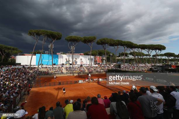 General view as storm clouds gather over court one during the second round match between Robin Haase of Holland and Carlos Berlocq of Argentina on...