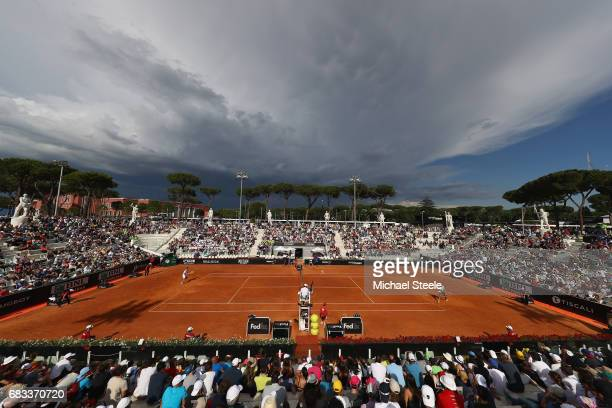 General view as storm clouds gather over Pietrangeli court during the second round match between Viktor Troicki of Serbia and Stefano Napolitano of...