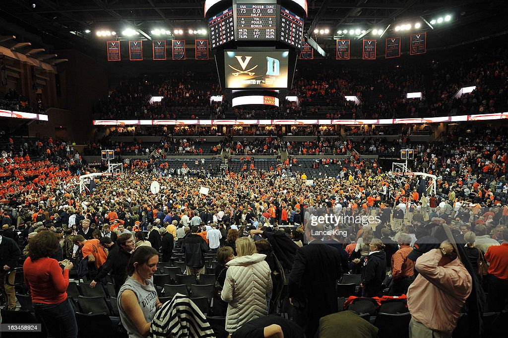 A general view as students and fans of the Virginia Cavaliers celebrate on the court following their game against the Duke Blue Devils at John Paul Jones Arena on February 28, 2013 in Charlottesville, Virginia. Virginia defeated Duke 73-68.
