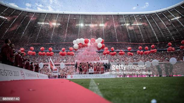 A general view as team mates of Muenchen celebrate with the trophy after the Bundesliga match between Bayern Muenchen and SC Freiburg at Allianz...