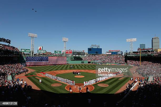 General view as the Boston Red Sox and the Washington Nationals stand on the field for the National Anthem before the game at Fenway Park on April 13...